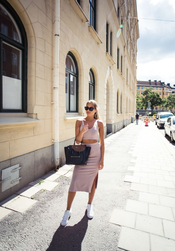 A two piece such as this is the ultimate summer style; practical, casual, and sexy. Kenza Zouiten wears this neutral combo with bright white sneakers for a cool street style which we love. Top/Skirt: Ivy Revel.