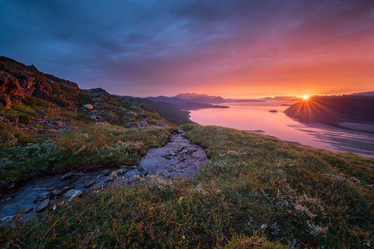 A beautiful sunrise lights up Reisafjorden in Nordreisa, Troms, Northern Norway. by Trichardsen