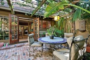 Eclectic Patio with Glass panel door, Mini blinds, Trellis, exterior brick floors, Verde patina wall lantern, French doors