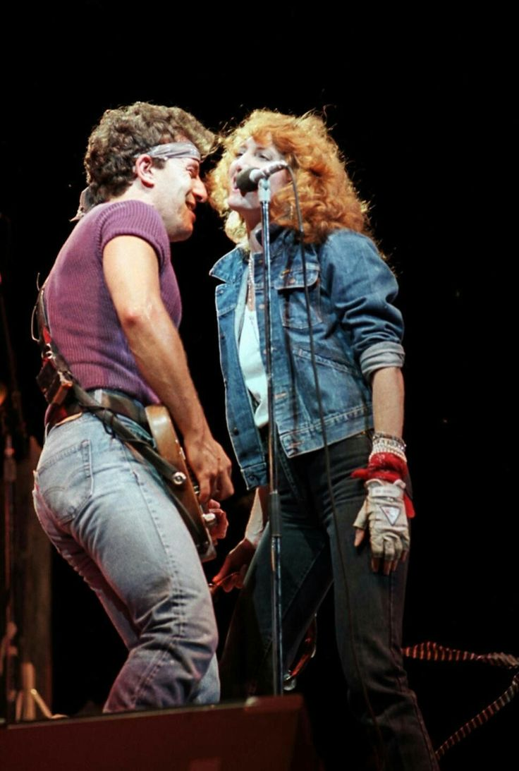 """Bruce Springsteen and Patti Scialfa during the """"Born in the USA"""" tour in 1985."""