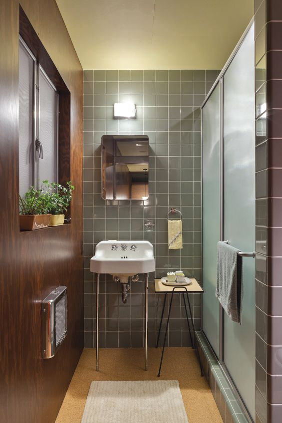 "This bath features a vintage sink and medicine cabinet obtained from a nearby demolition site, on new four-inch-square ceramic tile wall. The light fixture above is ""new old stock"" — 60 years old and never been used."