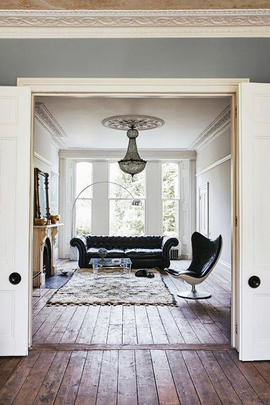 wooden floors, mid-century, french chandelier, black leather, Moroccan rug
