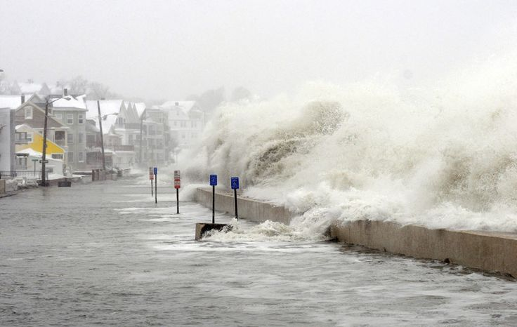 The ocean overflows the sea wall on Winthrop Shore Drive in Winthrop, Massachusetts, on February 9, 2013. An overnight blizzard left one to two feet of snow in areas, and coastal flooding is expected as the storm lingers into the day. (Darren McCollester/Getty Images)