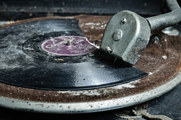 abandoned record player and broken record but the melody plays on.