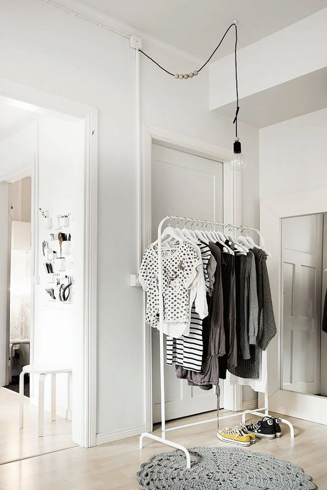 This exposed bulb over an #IKEA clothing rack is a stylish look for those without #closet space