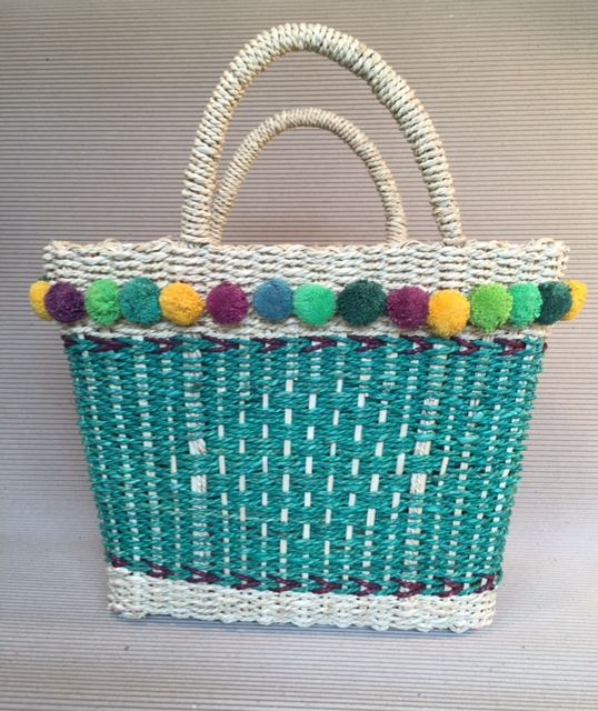 Hand woven  in Cambodia, these colourful baskets are a unique take on the traditional shopping basket.  Made from sturdy, heavy weight jute and wicker they are strong enough to accommodate your shopping, and are also perfect for the beach or as a quirky alternative to a handbag.   Dimensions:  30cm long at the base, 38cm long at the top and 15cm deep. Handles are approximately  12 cm in height.