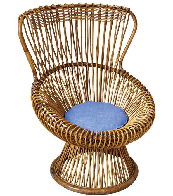 ''Cane and wicker bring a cozy, casual atmosphere to a room,'' she says of this Franco Albini Margherita chair