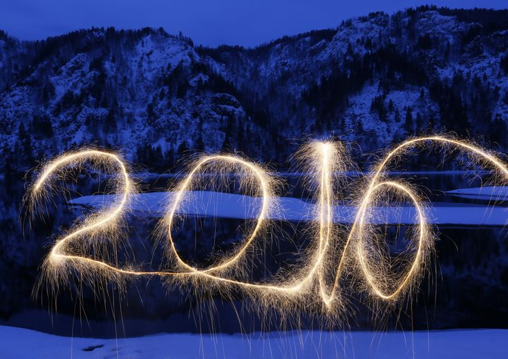 """The numbers """"2016"""" are written in the air with a sparkler on a bank of the Yenisei River in the Taiga district, near the town of Divnogorsk outside Siberian city of Krasnoyarsk, Russia. Picture taken with long exposure. Photo by Ilya Naymushin/Reuters"""