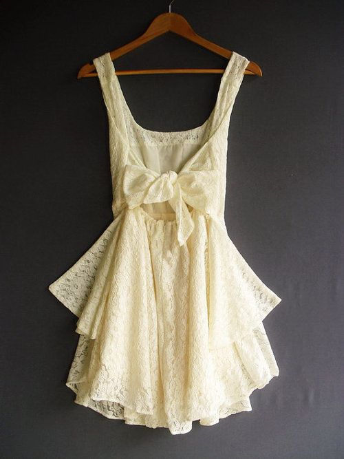 pretty cream lace dress with bow in the back