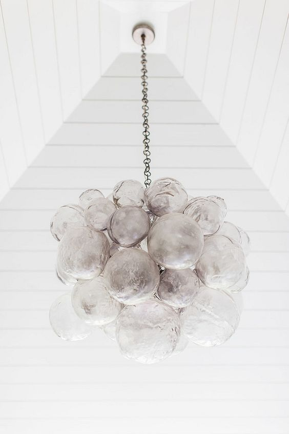 This Oly Studio piece known as the Muriel Cloud Chandelier is a favorite amongst designers. Made by artisans that shape each cast resin bubble to resemble our own personal cloud. The clear finish allo