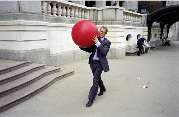 This image by Nick Turpin is a Street Scene taken in Broadgate, London. I like this photo because it just seems so odd. I immediately think what is he doing carrying this red ball down a city street while wearing a suit? This is a type of street photograph that I really enjoy, the ones that make you think and go why? what? ect. And for me this image does just that