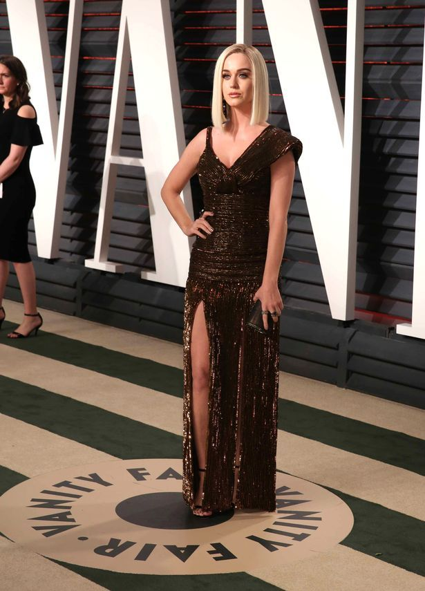 Katy Perry at 2017 Vanity Fair Oscar Party.    The singer, who debuted her new blonde locks recently, wore her hair down and poker straight.    Her shimmering dress was slit at the front to reveal some leg, and she looked absolutely gorgeous.