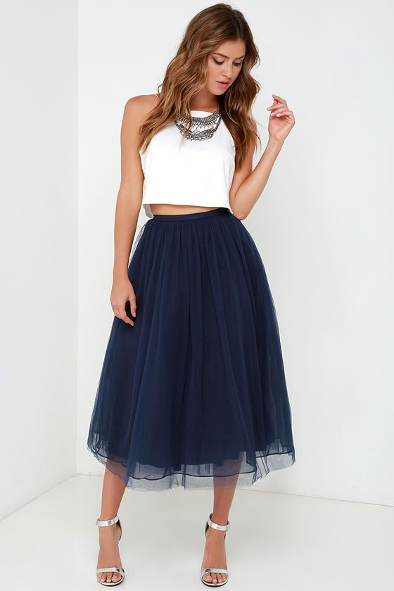 Every girl deserves to feel like royalty now and again, and with the Give it a Twirl Navy Blue Tulle Midi Skirt you'll create a look to rule them all! Several layers of navy blue tulle and silky soft organza gather at the fitted waistline before falling to a voluminous midi skirt. Hidden back zipper with clasp.