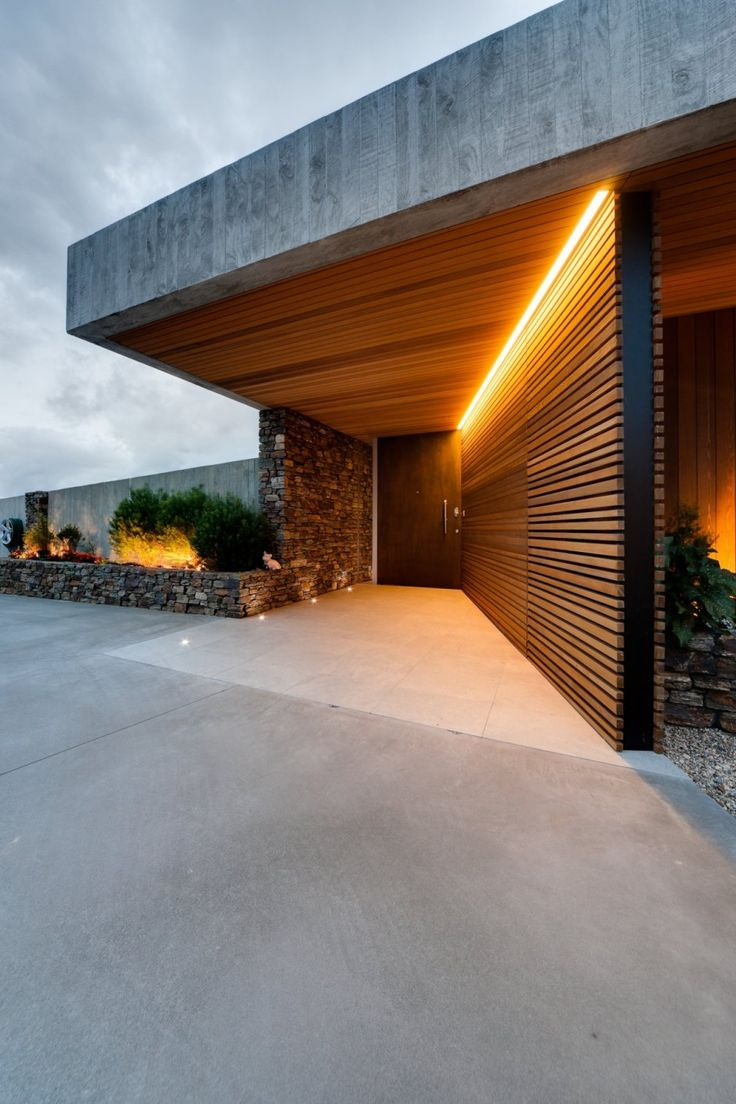 Bossley #house in Auckland | Horizontal planes - schist, horizontal wood, light , concrete slab