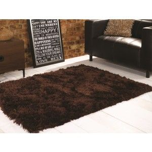 Brown Shaggy Sheepskin Rug made with 100% polyester. The 8.1cm pile gives a super soft feel. The luxury rug has a super price. http://www.therughouse.co.uk/sheepskin-rugs