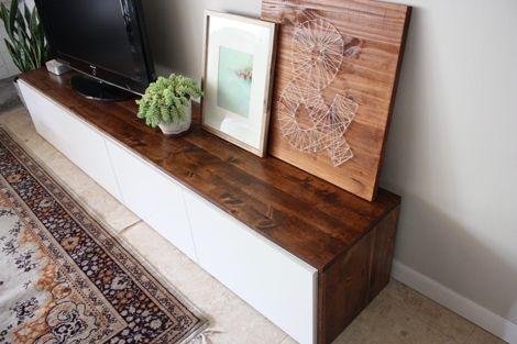 this is an Ikea Besta unit with a custom stained pine top. cost less than $200 to make. IT'S GORGEOUS.  Stained-DIY-media-cabinet via elisablaha blog