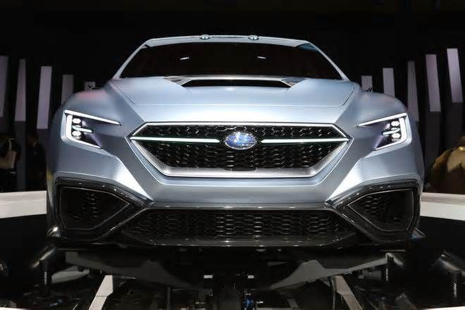 Five Design Details on the Subaru VIZIV Performance Concept Perspective makes it seem like they lead deep into the car's fiery bowels, but what are they? Subaru explained that's it a rear fog lamp but also a design element. I like it.