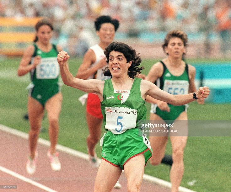 Hassiba Boulmerka from Algeria, jubilates after crossing the line to win the gold medal in the women's 1500m final, Barcelona, 08 August 1999. The other racers are: Tatiana Dorovskikh, Unified team (L), 4th place, Yunxia Qu, China (C), 3rd place, Lyudmila Rogacheva, Unified team (R), 2nd place.