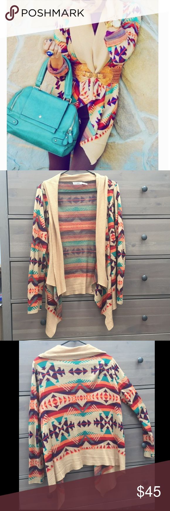 Colorful Aztec print cardigan from Blu Pepper Great condition. I love this sweater but the color scheme doesn't look as great on me as I'd hoped. Size is small, but it is flowy and would definitely fit a Med or maybe L. No buttons or closures but looks great under a belt or as a wrap. Blu Pepper Sweaters Cardigans