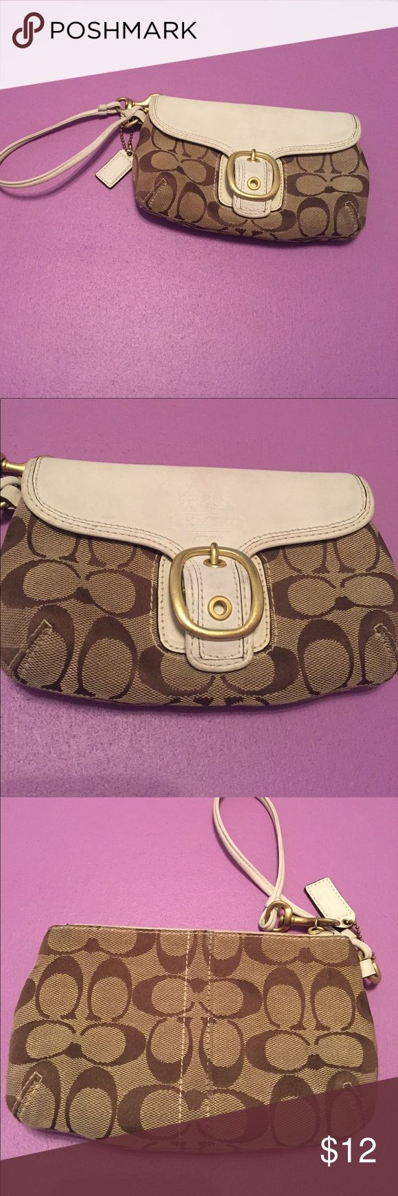 Coach wristlet! Classic Coach wristlet! Two-toned brown and and tan coach lettering and white leather with a gold buckle detail. There's two pockets. A fair amount of ware and tear, but the outside still looks good! Coach Bags Clutches & Wristlets