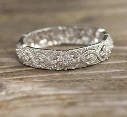 Need to find a wedding band like this, even if it's without the diamonds, so delicate and pretty