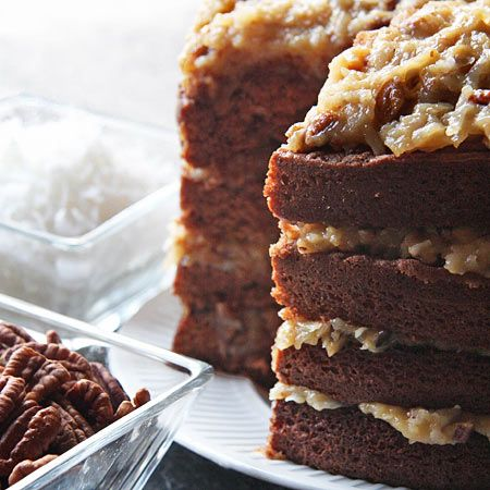 MARSHALL FIELD'S GERMAN CHOCO CAKE 4 oz Bakers German Sweet Chocolate 1/2 cup boiling water 2 1/2 cups sifted cake flour 1 tsp baking soda 1/2 tsp salt 1 cup butter or margarine 2 cups sugar 4 egg yolks, unbeaten 1 tsp vanilla 1 cup buttermilk 4 egg whites, stiffly beaten