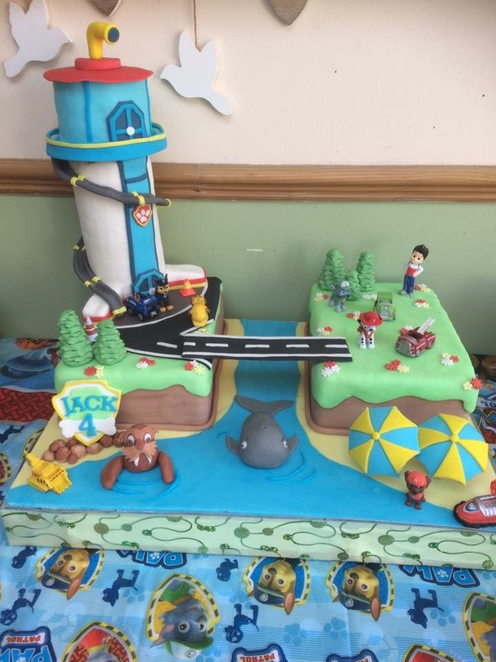 Paw patrol cake. dogs. Wallet, whale. Beech umbrellas. Adventure Bay. Lookout tower.