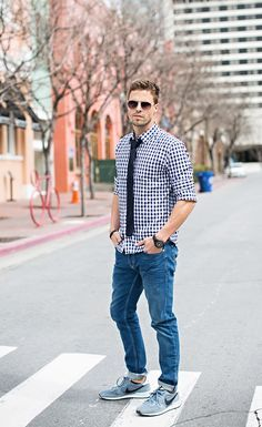 gingham pattern shirt untucked w/ light rinse denim.