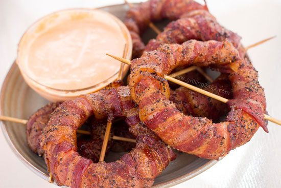 Smoked Bacon Wrapped Onion Rings. My notes: won't use hot sauce or that much pepper, but I've been craving onion rings and maybe this is the answer!