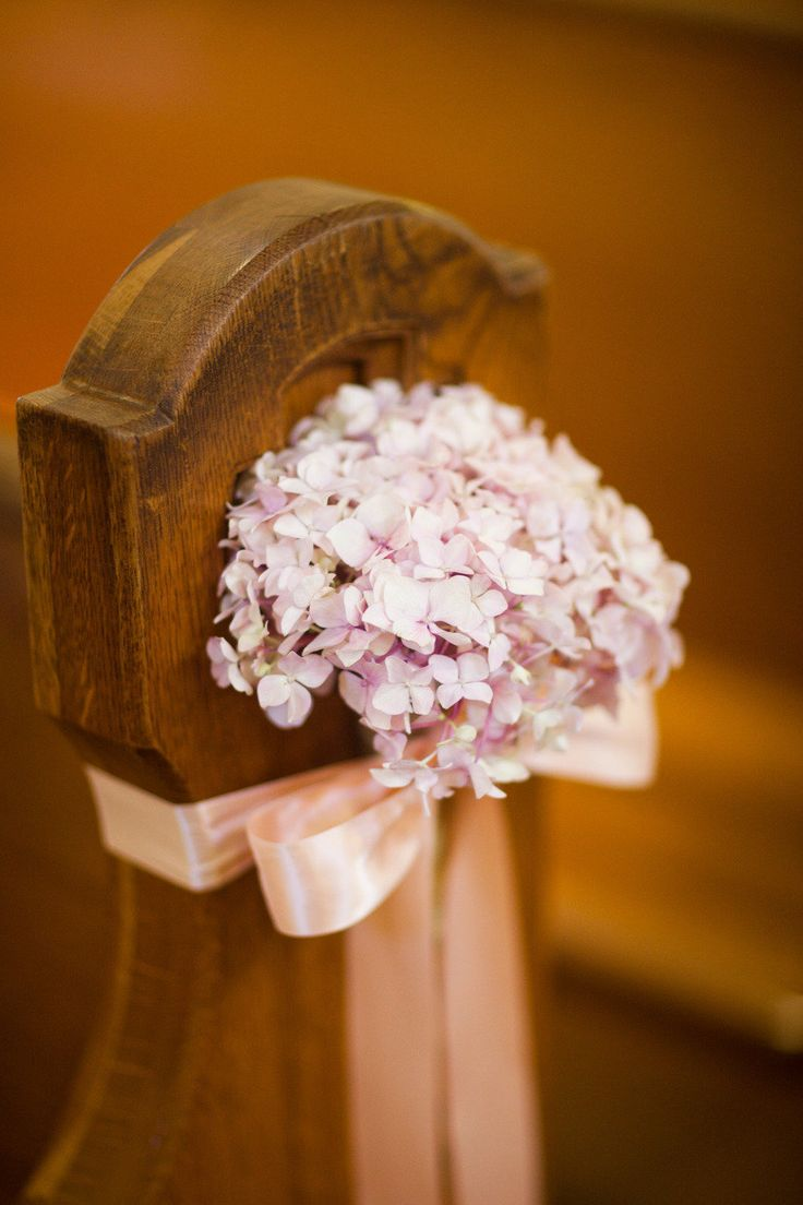 Hydrangea as church wedding aisle decor. Simple yet stunning. Seth, do you like this? In our colors obvi