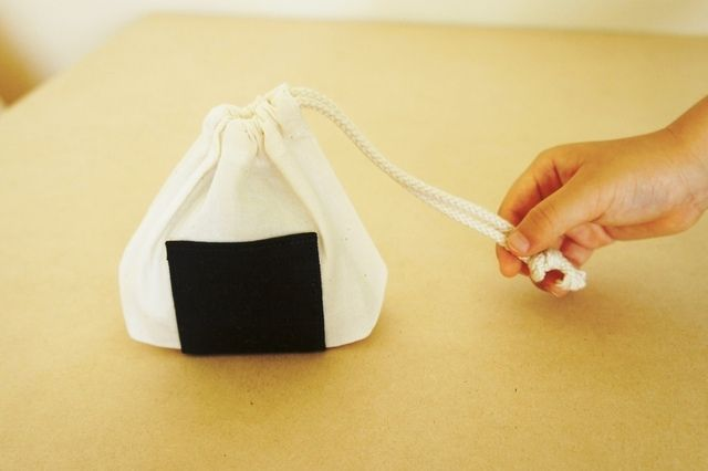 small bag in the shape of a rice ball | おにぎりきんちゃく