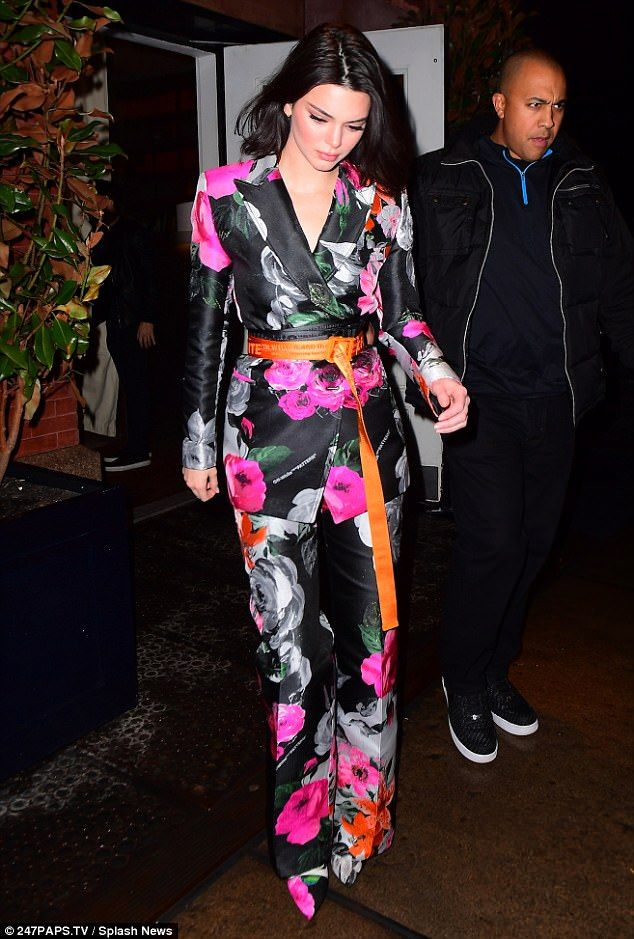 Pretty as a petal: Kendall oozed sophistication as she arrived in a black satin floral pan... #kendalljenner