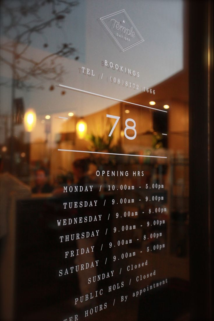 Opening Hours signage on glass entry doors to Temple Day Spa, Adelaide.