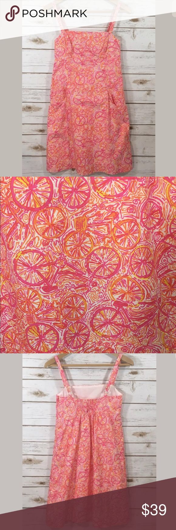 "Lilly Pulitzer Ten Speed Dress Lilly Pulitzer ""Ten Speed"" Lola sundress. Pink, orange, and white bicycle/bike print pattern. Side zip closure. Has 2 pockets on front. 100% cotton. Lined.  Labeled a size 2, women's. All brands are sized differently. Please review measurements to ensure a proper fit.   Bust: 28"" (has elastic in back so can stretch a little bit -- about 2-3 more inches) Waist: 27"" Hip: 36"" Length: 33""  Excellent preowned condition, no flaws to note. Was recently dry cleaned…"