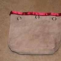 Bruine tas met knopen