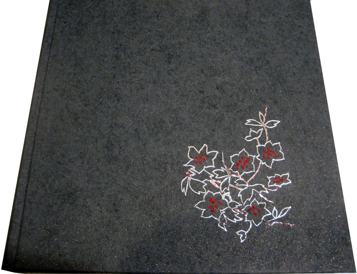 Photo Album .Cloth binding. Hot foil embossed dessign. Emroidered details with silk threads.