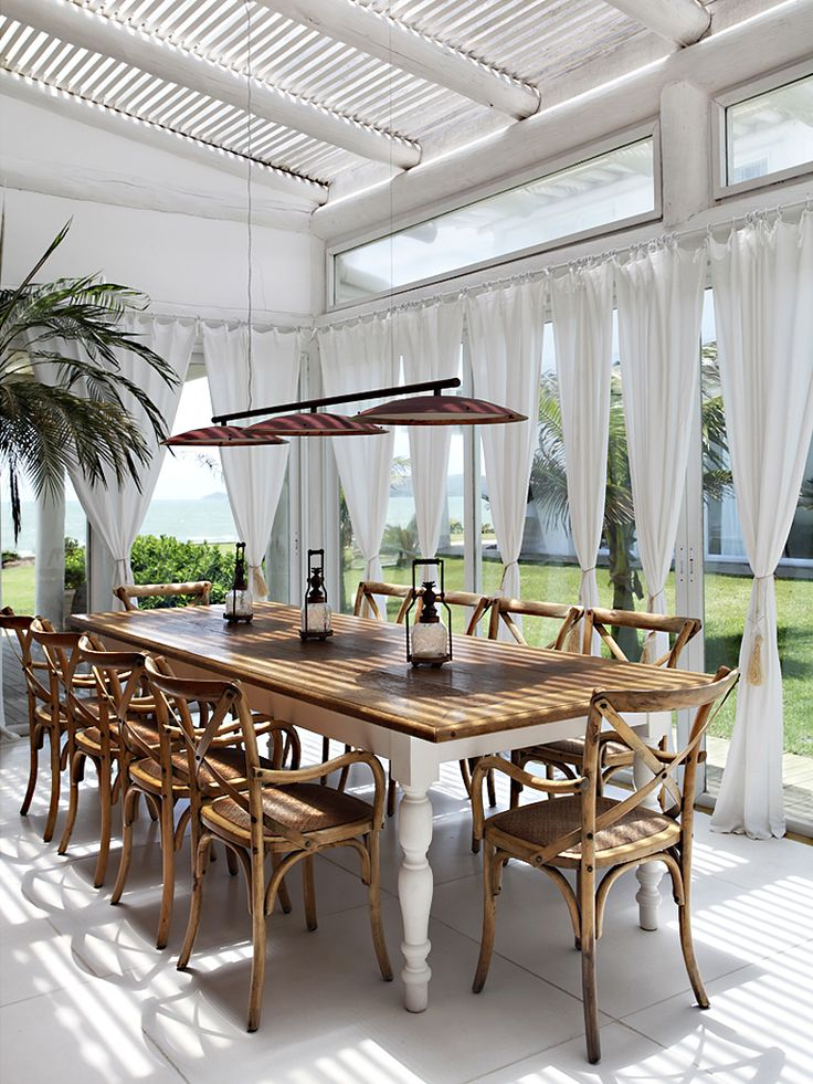 This is an awesome look for a porch, patio, or sunroom by the ocean.  British Colonial Style.