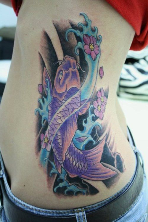 Colourful koi fish tattoo on rib tattoos anchors koi for Colourful koi fish