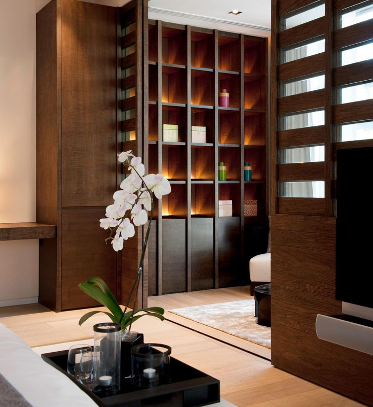 Wooden Lit Shelving An Elegant Touch With Some White Orchids SCDA Residence At Orchard Road Singapore