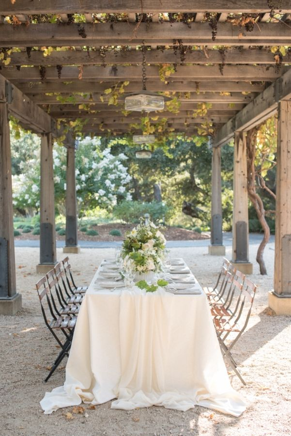 Outdoor white and greenery Italian inspired table decor: http://www.stylemepretty.com/california-weddings/carmel-valley/2016/11/18/three-ways-to-style-the-perfect-california-wedding/ Photography: Rahel Menig - http://www.rahelmenigphotography.com/