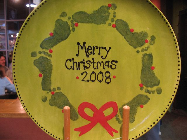 Porcelain plate purchased from Dollar Tree. Use porcelain paint for foot prints and porcelain pens for writing. They can be found at most craft stores. The directions are on the label. Let set 24 hours then bake at 350 degrees for 40 minutes.