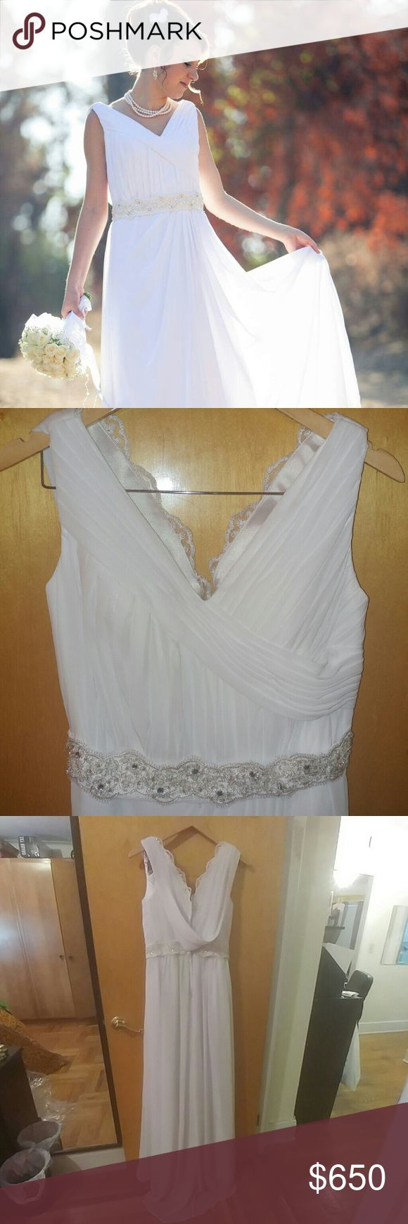 Bridal dress wedding dress Like new!!  Spacial made so the size is S/M it comes with a dress bag. The picture you see is my sister in law on her wedding day with the dress on. Dresses Wedding