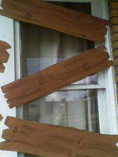 Use cardboard and brown paint to make faux boards to board up windows- I think I just added another thing to my party to-do list{sigh}
