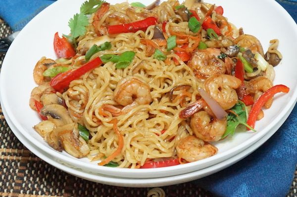 "You all already know that I have an undying love for indomie noodies. Here is a simple ""fancy"" indomie recipe to add to your arsenal  Ingredients:  	1 packet indomie noodles 	1 cup raw shrimp (cleaned) 	1 tablespoon cooking oil 	Vegetables of Choice  - Chopped- 1 cup plus  Direction:  	Remove seasoning from"