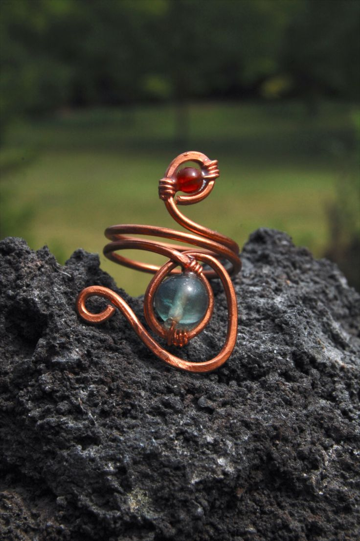 Hammered copper ring with glass bead and Carnelian semiprecious stone made by Macramilia Creations