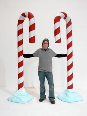 Giant Candy Cane Prop (Snow)  I like the proportions - at entrances of park? at entrance to Santa and ice rink?