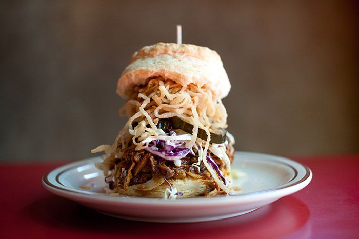 The Elmer. 10- hour-smoked pulled pork, BBQ sauce, fried onions, coleslaw & housemade pickles.