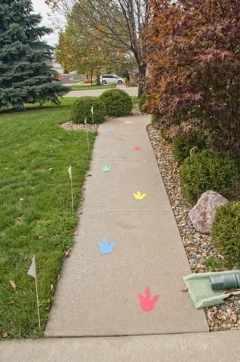 dinosaur foot prints leading to party. Dinosaur Birthday Party