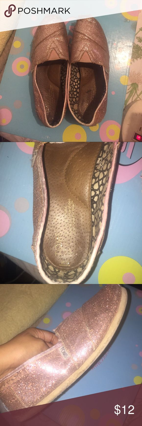 Pink glitter toms Few tears in the front. Insides are still good. Obvious signs of wear. TOMS Shoes Slippers