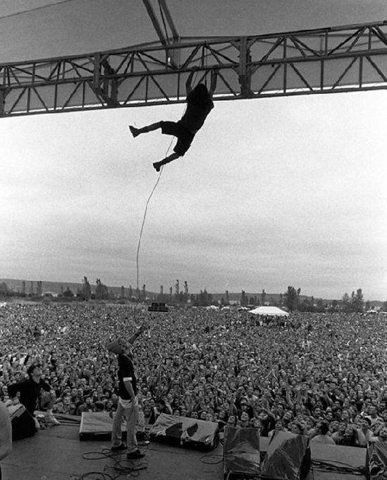 Eddie Vedder swinging from the rafters in Seattle, 1992